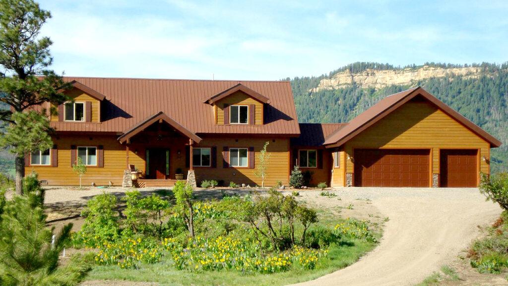 CUSTOM HOME WITH DORMERS, AND CEMENT BOARD SIDING