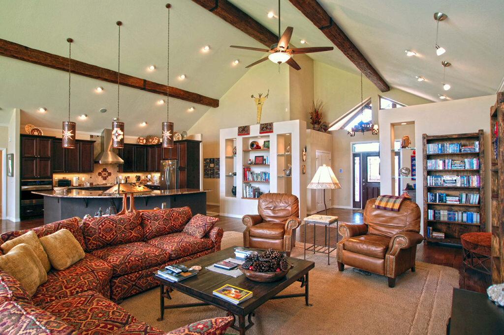 LIVING ROOM WITH CUSTOM DISPLAY WALLS, VAULTED CEILING AND SPECIAL LIGHTING