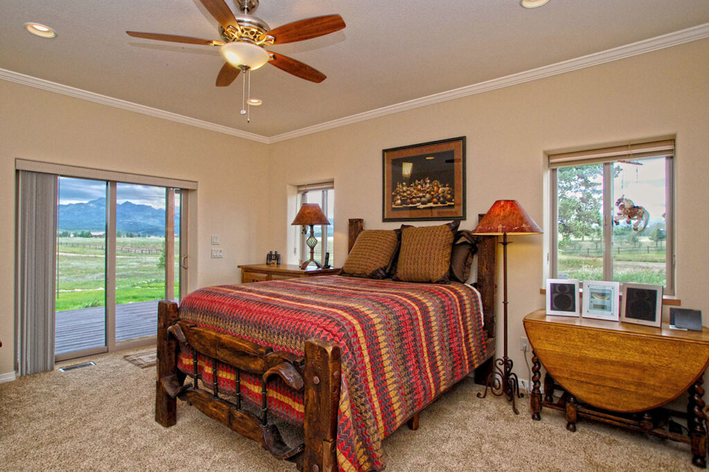 BEDROOM WITH CARPET, AND CROWN MOLDING TRIM