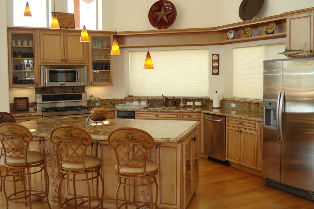 KITCHEN WITH SOLID GRANITE COUNTERTOPS, DECORATIVE CABINET DOORS, AND STAINLESS STEEL APPLIANCES