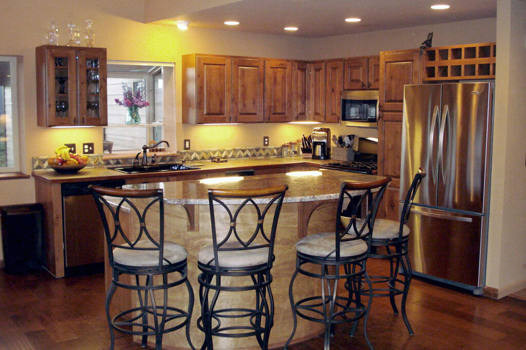 KITCHEN WITH CUSTOM BAR, AND STAINLESS STEEL APPLIANCES