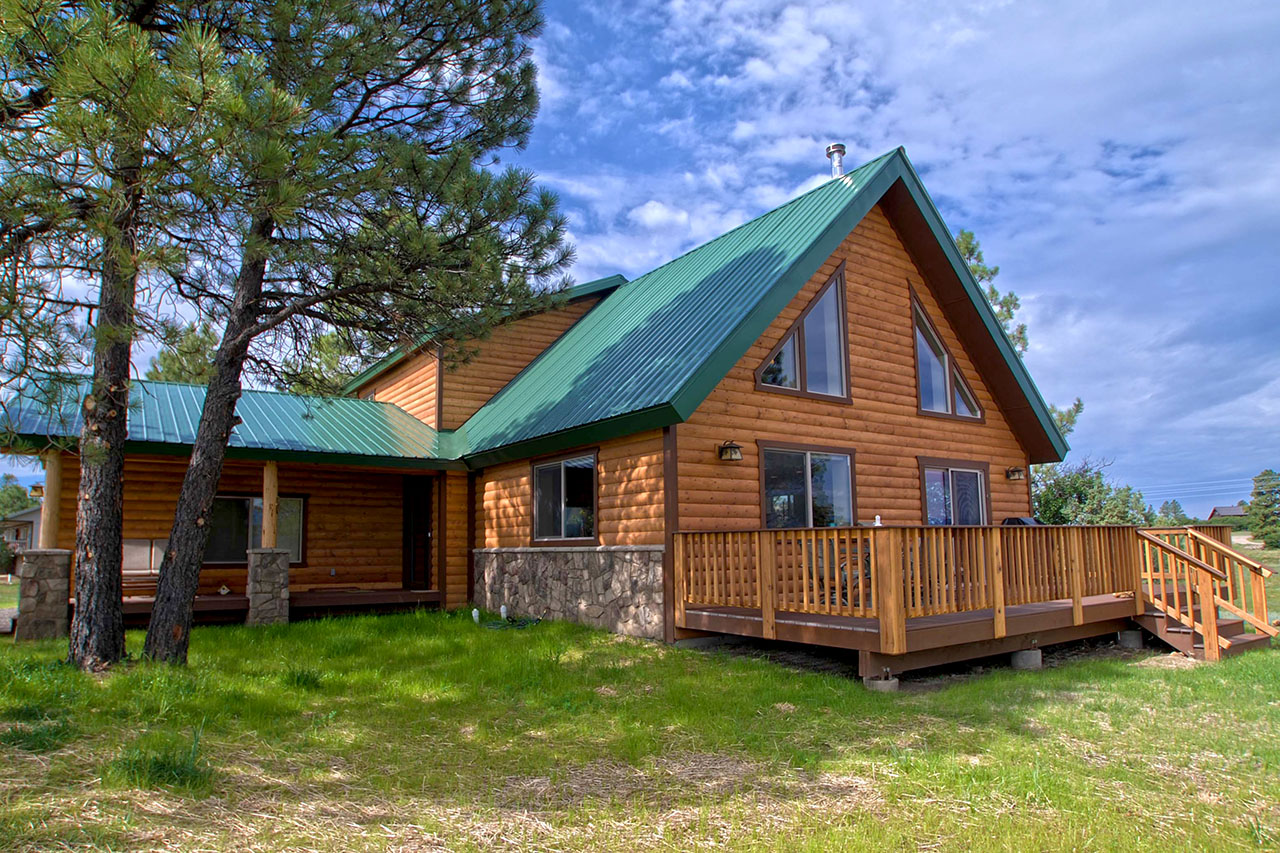 MODIFIED GARNET WITH REAL LOG SIDING EXTERIOR