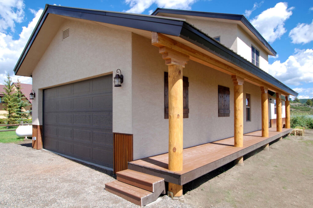 MODIFIED GARNET WITH STUCCO EXTERIOR AND LOG POSTS